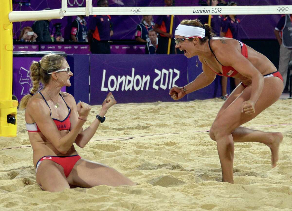 Misty May-Treanor and Kerri Walsh celebrate at the end of the women Beach Volleyball final match against April Ross and Jennifer Kessy on the Centre Court Stadium in Horse Guards Parade on London on August 08, 2012, for the London 2012 Olympic Games. May-Treanor/Walsh won the gold medal. AFP PHOTO / DANIEL GARCIADANIEL GARCIA/AFP/GettyImages