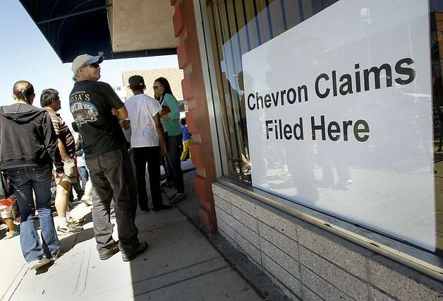 The line of claimants was out the door at the law offices of Nick Haney. Photo: Brant Ward, The Chronicle