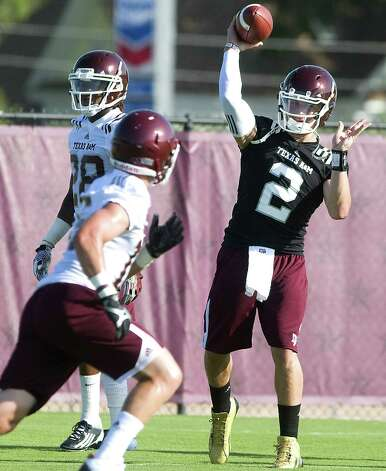 Texas A&M redshirt freshman quarterback Johnny Manziel (2) throws passes on the first day of the team's NCAA college fall football practice in College Station, Aug. 3, 2012. Photo: Stuart Villanueva, AP Photo/Bryan College Station Eagle / Bryan College Station Eagle