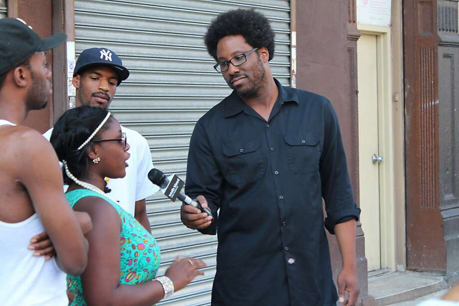 "W. Kamau Bell (right) interviews residents of Harlem about New York's ""stop and frisk"" law on the premiere of his topical weekly show on FX, ""Totally Biased With W. Kamau Bell."" Photo: Alex Thornton, FX"