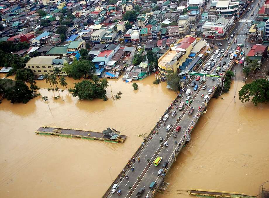 This photo released by the Department of National Defense shows flooded areas in Marikina, east of Manila, Philippines. Widespread flooding battered a million others and paralyzed the Philippine capital began to ease Wednesday as cleanup and rescue efforts focused on a large number of distressed residents, some still marooned on their roofs. Photo: Department Of National Defense, Associated Press