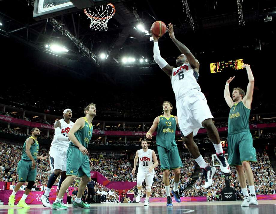 LONDON, ENGLAND - AUGUST 08:  LeBron James #6 of United States goes up for a shot between David Andersen #13 and Joe Ingles #7 of Australia in the first half during the Men's Basketball quaterfinal game on Day 12 of the London 2012 Olympic Games at North Greenwich Arena on August 8, 2012 in London, England. Photo: Christian Petersen, Getty Images / 2012 Getty Images