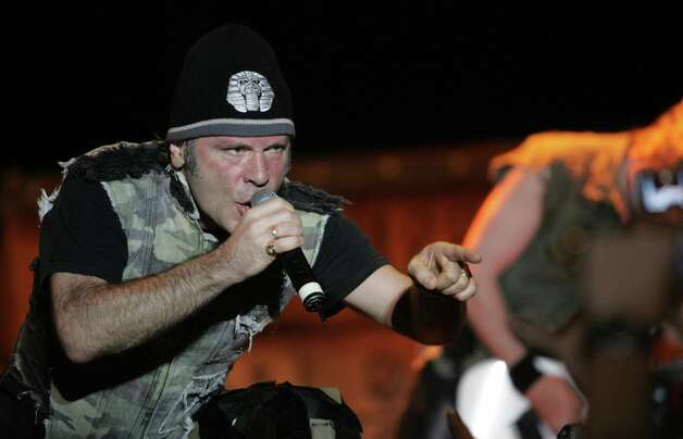 Bruce Dickinson, singer of heavy metal band Iron Maiden, performs on March 03, 2009 at Ricardo Morera Soto Stadium in Alajuela, 22 kilometers north of San Jose, as part of the concert Scream For Me Costa Rica!, where thousands of Costa Rican and foreign fans sang the most popular tunes of the English band.        AFP PHOTO/Mayela LOPEZ Photo: MAYELA LOPEZ, AFP/Getty Images / 2009 AFP