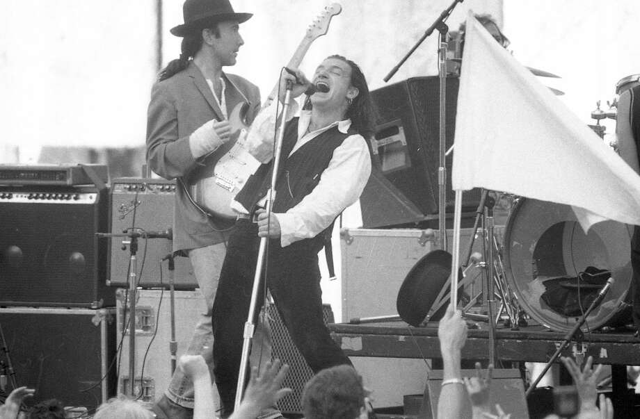 """Recording for the documentary """"Rattle and Hum,"""" the band sang several covers including """"All Along the Watchtower"""" and Curtis Mayfield's """"People Get Ready."""" The crowd was in good spirits. What could possibly go wrong? (Fred Larson / The Chronicle)"""