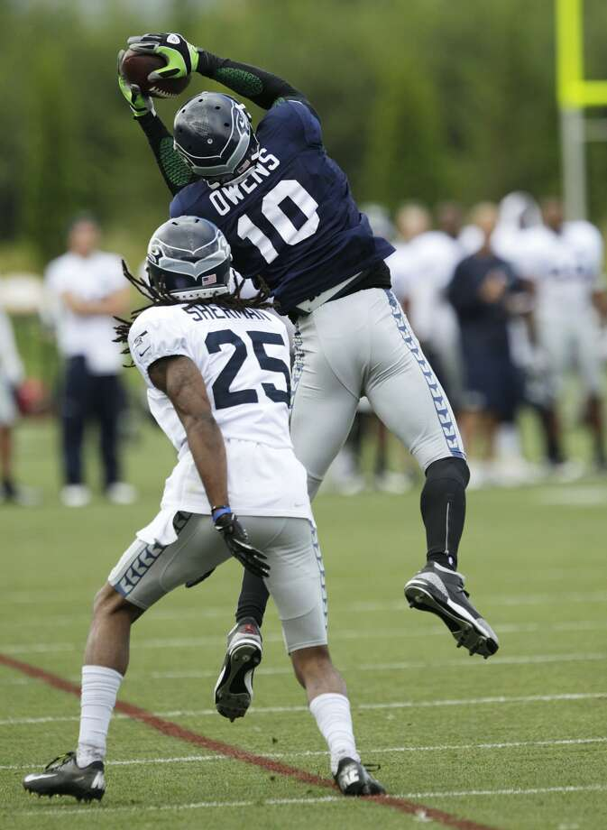 Seattle Seahawks' Terrell Owens (10) makes a catch around the defense of cornerback Richard Sherman (25) during NFL football training camp, Wednesday, Aug. 8, 2012, in Renton, Wash. (Ted S. Warren / Associated Press)