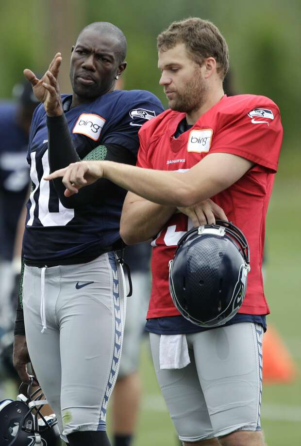 Seattle Seahawks wide receiver Terrell Owens, left, talks with quarterback Matt Flynn, right, during NFL football training camp, Wednesday, Aug. 8, 2012, in Renton, Wash. (Ted S. Warren / Associated Press)
