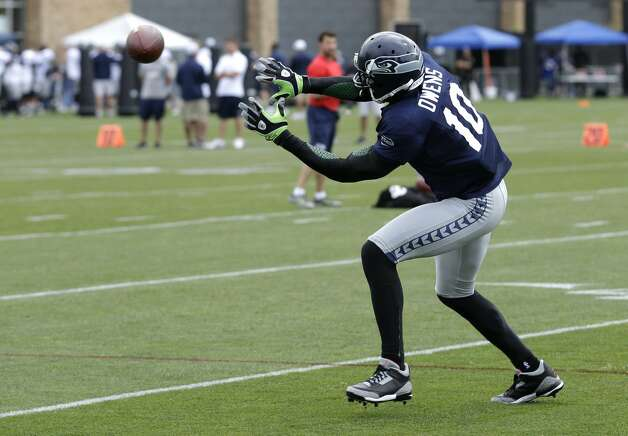 Seattle Seahawks' Terrell Owens catches a pass during NFL football training camp, Wednesday, Aug. 8, 2012, in Renton, Wash. (Ted S. Warren / Associated Press)