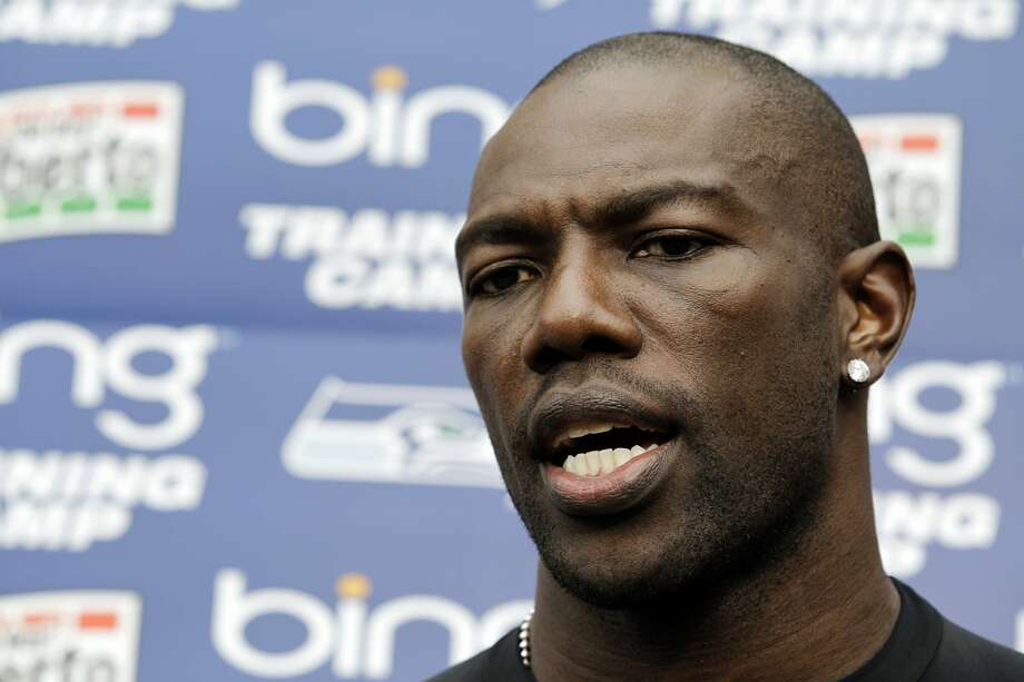 Seattle Seahawks wide receiver Terrell Owens talks to reporters following his first day with the team at NFL football training camp, Wednesday, Aug. 8, 2012, in Renton, Wash. (Ted S. Warren / Associated Press)