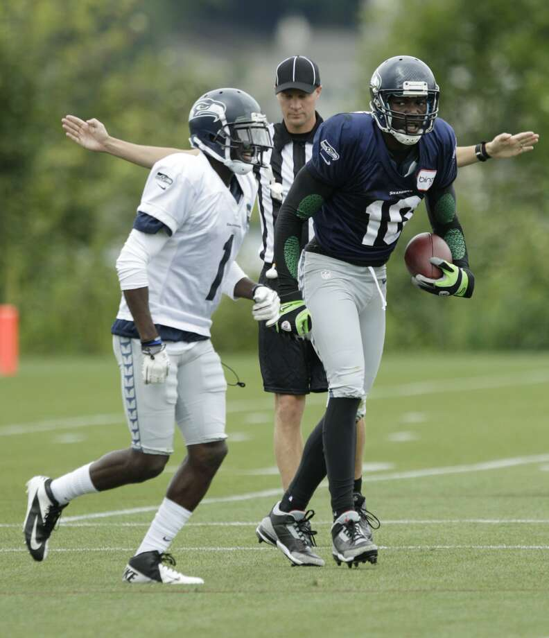 Seattle Seahawks wide receiver Terrell Owens, right, looks at cornerback Jeremy Lane, left, after a play during NFL football training camp on Wednesday, Aug. 8, 2012, in Renton, Wash. (Ted S. Warren / Associated Press)