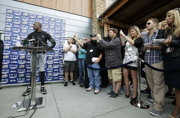 Seattle Seahawks' Terrell Owens is shown taking questions from reporters during NFL football training camp, Wednesday, Aug. 8, 2012, in Renton, Wash. (Ted S. Warren / Associated Press)