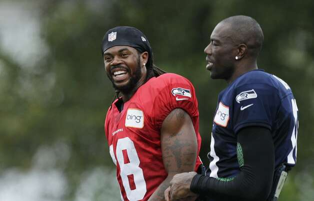 Seattle Seahawks wide receivers Terrell Owens, right, and Sidney Rice, left, during NFL football training camp, Wednesday, Aug. 8, 2012, in Renton, Wash. (Ted S. Warren / Associated Press)