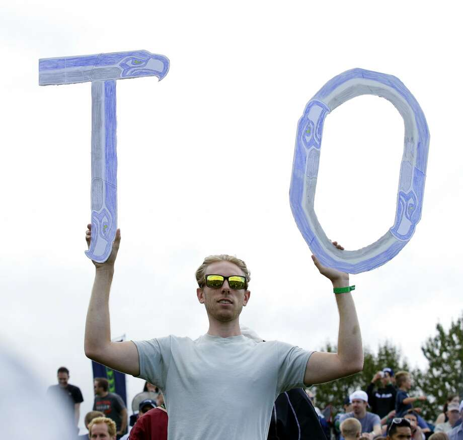 A fan of Seattle Seahawks' Terrell Owens is shown during NFL football training camp, Wednesday, Aug. 8, 2012, in Renton, Wash. (Ted S. Warren / Associated Press)