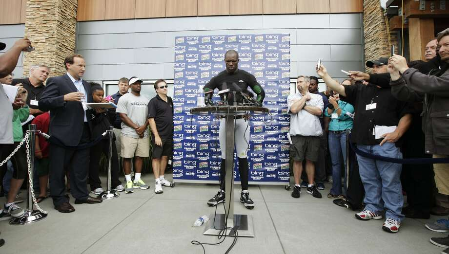 Seattle Seahawks' Terrell Owens is shown talking to reporters during NFL football training camp, Wednesday, Aug. 8, 2012, in Renton, Wash. (Ted S. Warren / Associated Press)
