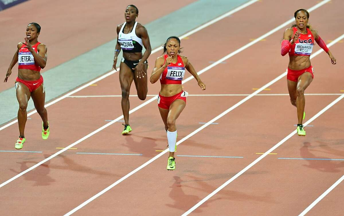 (FromL) US' Carmelita Jeter, Ivory Coast's Murielle Ahoure, US' Allyson Felix and US' Sanya Richards-Ross compete in the women's 200m final at the athletics event of the London 2012 Olympic Games on August 8, 2012 in London. AFP PHOTO / GABRIEL BOUYSGABRIEL BOUYS/AFP/GettyImages
