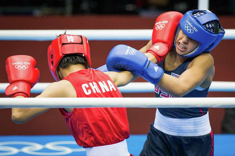 Marlen Esparza of the USA, in blue, fights Ren Cancan of China in women's semifinal flyweight 51-kg