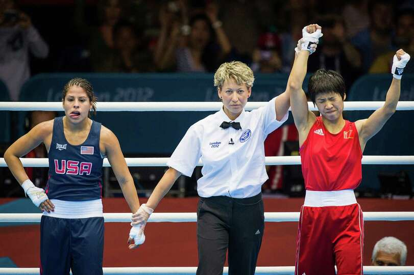 Marlen Esparza of the USA, in blue, reacts as referee Veronika Szucs raises the hand of her opponent