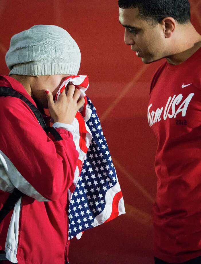 Boxer Marlen Esparza uses her bandana to wipe away tears as talks with her coach Rudy Silva after a loss to Ren Cancan of China in women's semifinal flyweight 51-kg boxing match at the 2012 London Olympics on Wednesday, Aug. 8, Photo: Smiley N. Pool, Houston Chronicle / © 2012  Houston Chronicle