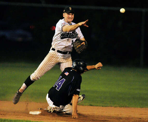 Danbury second baseman Jake Gronsky forces out Keene's Cameron O'Brien during game 2 of their Western Division playoff game at Rogers Park in Danbury on Wednesday, Aug. 8, 2012. Danbury won, 12-11, advancing to the finals against the Newport Gulls. Photo: Jason Rearick / The News-Times