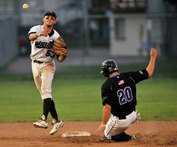 Danbury shortstop Zach Shank forces out Keene's Dylan DelaCruz during game 2 of their Western Division playoff game at Rogers Park in Danbury on Wednesday, Aug. 8, 2012. Danbury won, 12-11, advancing to the finals against the Newport Gulls. Photo: Jason Rearick / The News-Times