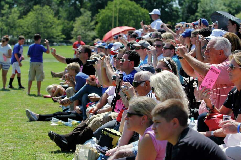 New York Giants fans grab their cameras to photograph the training camp practice at the University at Albany campus, Wednesday Aug. 8, 2012 in Albany, N.Y. (Dan Little/Special to the Times Union) Photo: Dan Little / Dan Little