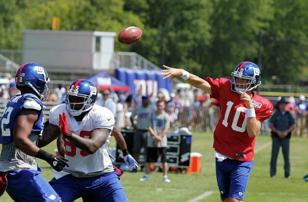 New York Giants quarterback #10 Eli Manning throws a pass during the preseason training camp at the University at Albany campus, Wednesday Aug. 8, 2012 in Albany, N.Y. (Dan Little/Special to the Times Union) Photo: Dan Little / Dan Little