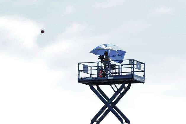 A football flies toward a film crew member stationed behind the goalpost during special teams practice at the New York Giants preseason training camp at the University at Albany campus, Wednesday Aug. 8, 2012 in Albany, N.Y. (Dan Little/Special to the Times Union) Photo: Dan Little / Dan Little