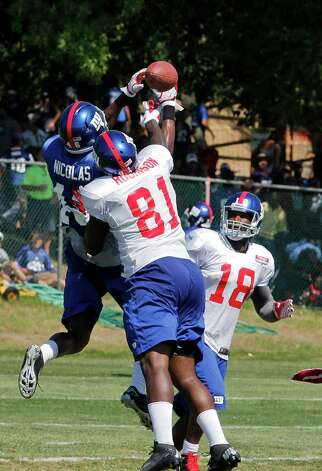 New York Giants wide receiver #81 Adrien Robinson battles for the ball with tight end #46 Jojo Nicolas on a pass play during the preseason training camp at the University at Albany campus, Wednesday Aug. 8, 2012 in Albany, N.Y. (Dan Little/Special to the Times Union) Photo: Dan Little / Dan Little