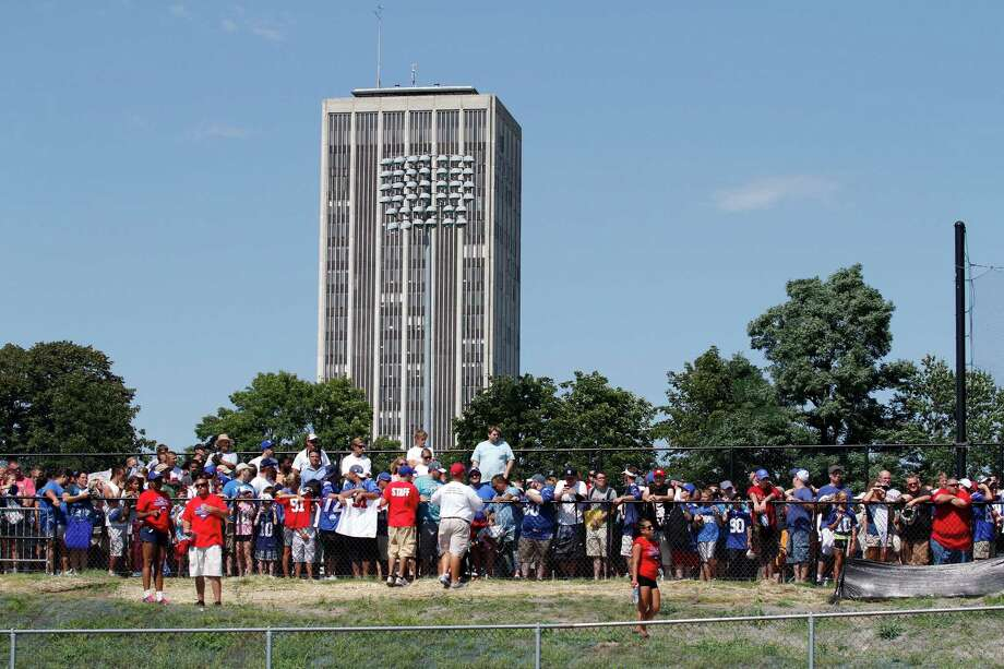Fans crowd to the fences to see the New York Giants training camp at the University at Albany campus, Wednesday Aug. 8, 2012 in Albany, N.Y. (Dan Little/Special to the Times Union) Photo: Dan Little / Dan Little