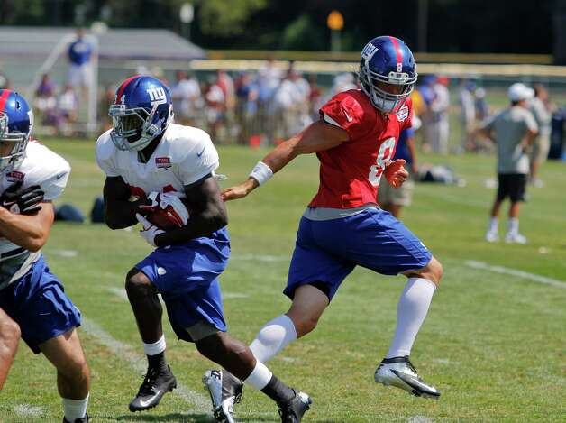 New York Giants quarterback #8 David Carr hands the ball off to running back #34 David Wilson during the preseason training camp at the University at Albany campus, Wednesday Aug. 8, 2012 in Albany, N.Y. (Dan Little/Special to the Times Union) Photo: Dan Little / Dan Little