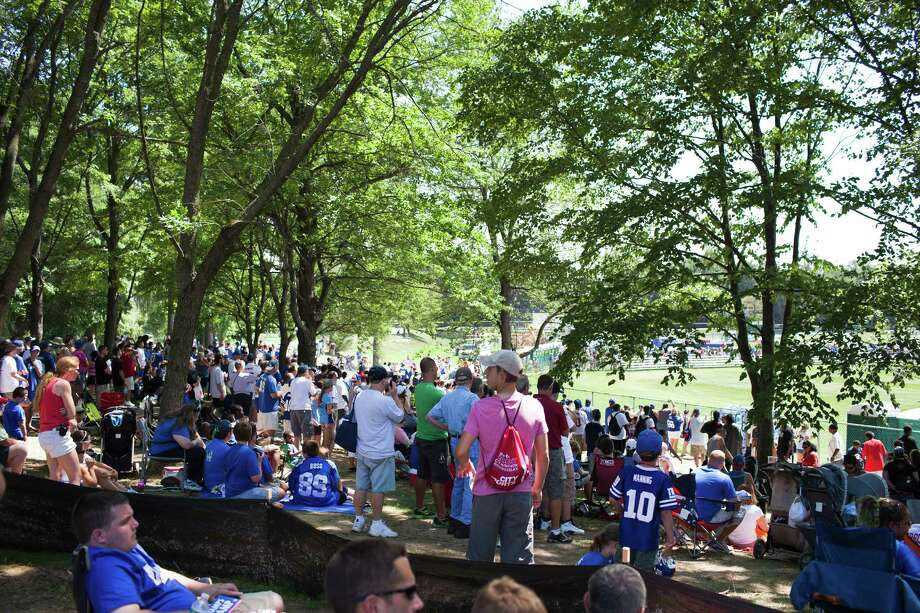 Fans crowd around the New York Giants training camp at the University at Albany campus, Wednesday Aug. 8, 2012 in Albany, N.Y. (Dan Little/Special to the Times Union) Photo: Dan Little / Dan Little