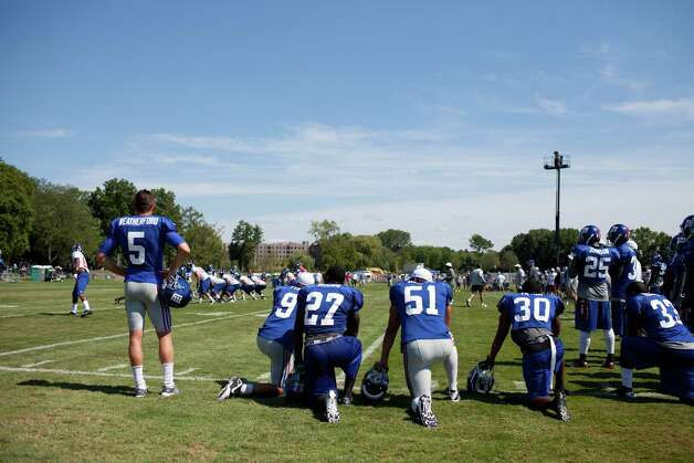 Members of the New York Giants watch from the sidelines while the offensive and defensive teams run plays on the field during the preseason training camp at the University at Albany campus, Wednesday Aug. 8, 2012 in Albany, N.Y. (Dan Little/Special to the Times Union) Photo: Dan Little / Dan Little