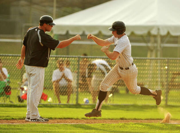 Danbury's Jake Gronsky rounds the bases after hitting a home run in the first inning during game 2 of their Western Division playoff game against Keene at Rogers Park in Danbury on Wednesday, Aug. 8, 2012. Danbury won, 12-11, advancing to the finals against the Newport Gulls. Photo: Jason Rearick / The News-Times
