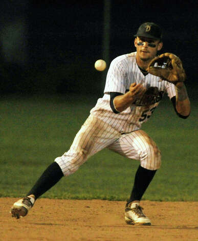 Danbury shortstop Zach Shank fields a ball during game 2 of their Western Division playoff game against Keene at Rogers Park in Danbury on Wednesday, Aug. 8, 2012. Danbury won, 12-11, advancing to the finals against the Newport Gulls. Photo: Jason Rearick / The News-Times
