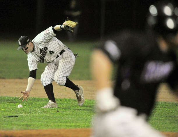 Danbury third baseman Mathew Boulter bare-hands a ball hit to him during game 2 of their Western Division playoff game against Keene at Rogers Park in Danbury on Wednesday, Aug. 8, 2012. Danbury won, 12-11, advancing to the finals against the Newport Gulls. Photo: Jason Rearick / The News-Times