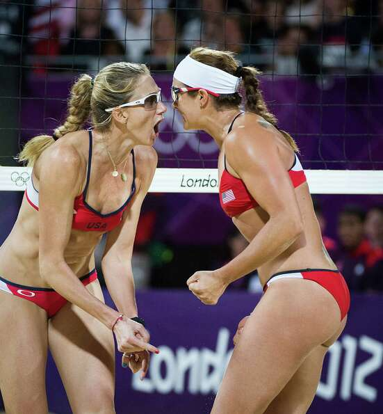Kerri Walsh Jennings, left, and Misty May-Treanor celebrate after making a point during the women's