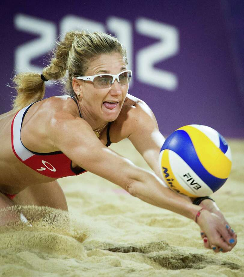 Kerri Walsh Jennings digs a ball during the women's beach volleyball gold medal match at the 2012 London Olympics on Wednesday, Aug. 8, 2012. Photo: Smiley N. Pool, Houston Chronicle / © 2012  Houston Chronicle