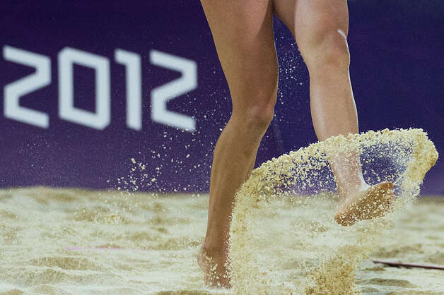 April Ross kicks up sand during the women's beach volleyball gold medal match at the 2012 London Olympics on Wednesday, Aug. 8, 2012. Photo: Smiley N. Pool, Houston Chronicle / © 2012  Houston Chronicle