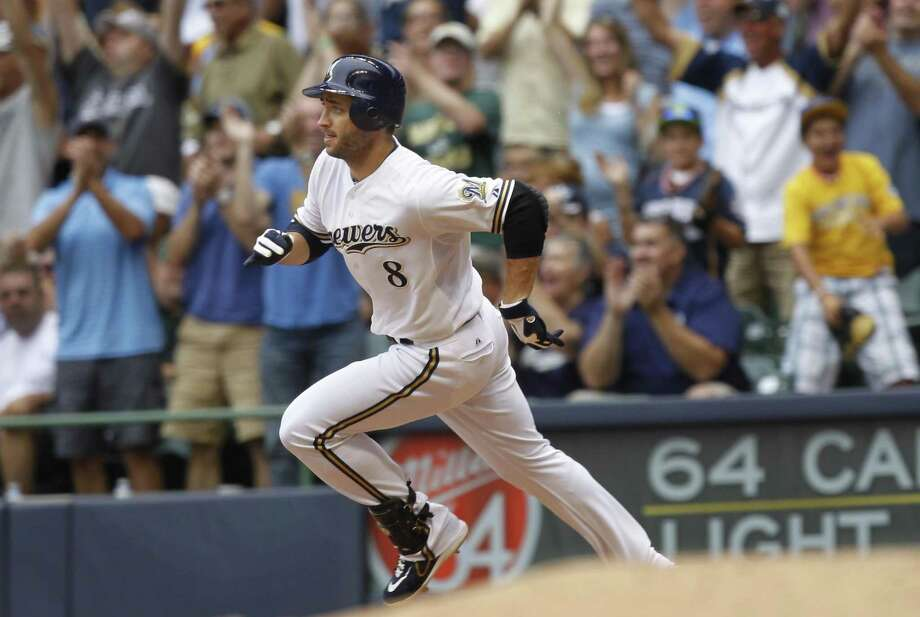 Milwaukee Brewers' Ryan Braun hits a double, scoring Carlos Gomez, in the 8th inning of a MLB game against the Cincinnati Reds at Miller Park in Milwaukee, Wisconsin, Wednesday, August 8, 21012. Photo: Rick Wood, McClatchy-Tribune News Service / Milwaukee Journal Sentinel