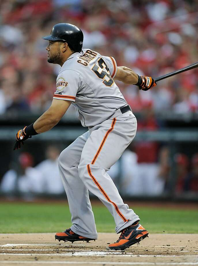 San Francisco Giants' Melky Cabrera watches his single during the first inning of a baseball game against the St. Louis Cardinals on Wednesday, Aug. 8, 2012, in St. Louis. The Giants won 15-0. (AP Photo/Jeff Curry) Photo: Jeff Curry, Associated Press