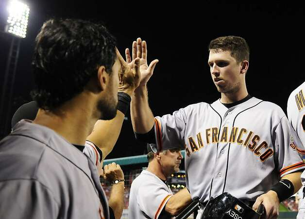 San Francisco Giants' Buster Posey, right, high-fives Angel Pagan after scoring on a fielding error by St. Louis Cardinals second baseman Tyler Greene during the sixth inning of a baseball game Wednesday, Aug. 8, 2012, in St. Louis. (AP Photo/Jeff Curry) Photo: Jeff Curry, Associated Press