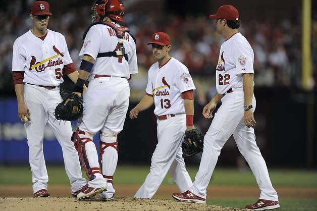 St. Louis Cardinals starting pitcher Joe Kelly, left, waits to be removed from the baseball game by manager Mike Matheny (22) during the sixth inning against the San Francisco Giants on Wednesday, Aug. 8, 2012, in St. Louis. (AP Photo/Jeff Curry) Photo: Jeff Curry, Associated Press