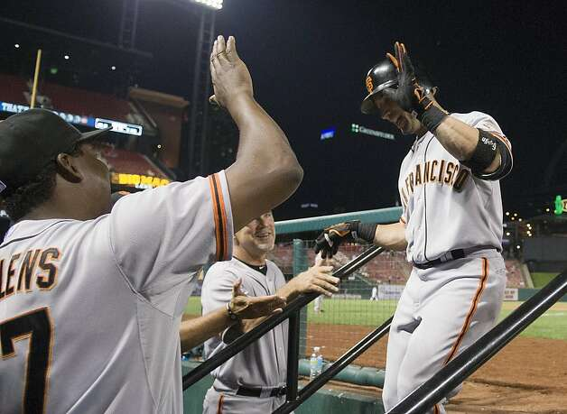 San Francisco Giants' Marco Scutaro, right, high-fives Hensley Meulens after hitting a grand slam during the ninth inning of a baseball game against the St. Louis Cardinals Wednesday, Aug. 8, 2012, in St. Louis. The Giants won 15-0. (AP Photo/Jeff Curry) Photo: Jeff Curry, Associated Press