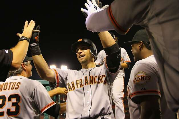 Marco Scutaro capped the Giants' perfect offensive outburst with a grand slam in the ninth inning Wednesday night. Photo: Dilip Vishwanat, Getty Images