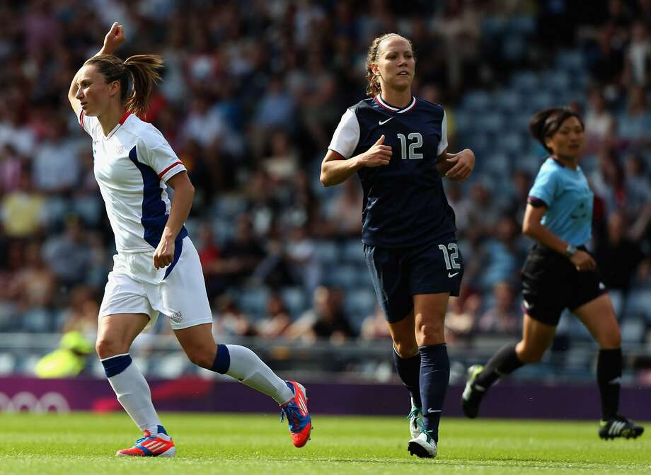 GLASGOW, SCOTLAND - JULY 25:  Gaetane Thiney of France (L) celebrates after scoring a goal as Lauren Cheney of USA looks on during the Women's Football first round Group G Match of the London 2012 Olympic Games between United States and France, at Hampden Park on July 25, 2012 in Glasgow, Scotland.  (Photo by Stanley Chou/Getty Images) (Stanley Chou / Getty Images)