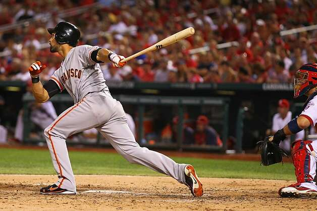 ST. LOUIS, MO - AUGUST 8: Angel Pagan #16 of the San Francisco Giants hits a sacrifice RBI against the St. Louis Cardinals at Busch Stadium on August 8, 2012 in St. Louis, Missouri.  (Photo by Dilip Vishwanat/Getty Images) Photo: Dilip Vishwanat, Getty Images
