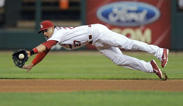 St. Louis Cardinals second baseman Tyler Greene dives for a ground ball hit for a single by San Francisco Giants' Angel Pagan during the third inning of a baseball game Wednesday, Aug. 8, 2012, in St. Louis. (AP Photo/Jeff Curry) Photo: Jeff Curry, Associated Press