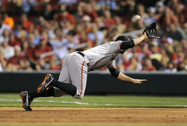 San Francisco Giants first baseman Brandon Belt dives but can't make a play on a ball hit by St. Louis Cardinals' Matt Carpenter for a triple during the sixth inning of a baseball game Wednesday, Aug. 8, 2012, in St. Louis. The Giants won 15-0. (AP Photo/Jeff Curry) Photo: Jeff Curry, Associated Press