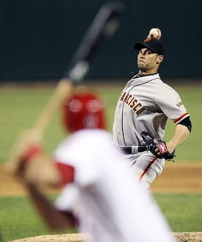 San Francisco Giants starting pitcher Ryan Vogelsong delivers against the St. Louis Cardinals during a baseball game, Wednesday, Aug. 8, 2012, in St. Louis. The Giants won 15-0. (AP Photo/St. Louis Post-Dispatch, Chris Lee)  EDWARDSVILLE INTELLIGENCER OUT; THE ALTON TELEGRAPH OUT Photo: Chris Lee, Associated Press