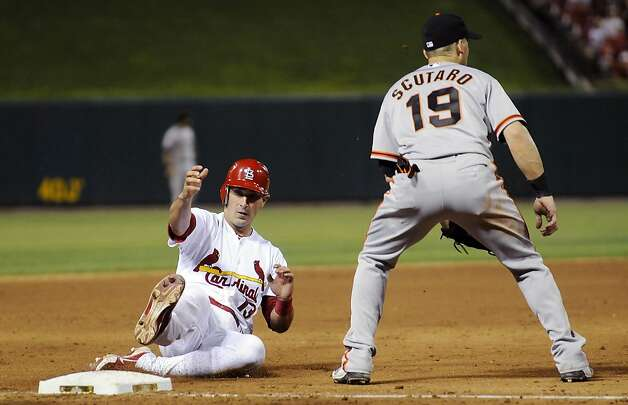 St. Louis Cardinals' Matt Carpenter (13) slides safely past San Francisco Giants third baseman Marco Scutaro for a triple during the sixth inning of a baseball game Wednesday, Aug. 8, 2012, in St. Louis. The Giants won 15-0. (AP Photo/Jeff Curry) Photo: Jeff Curry, Associated Press