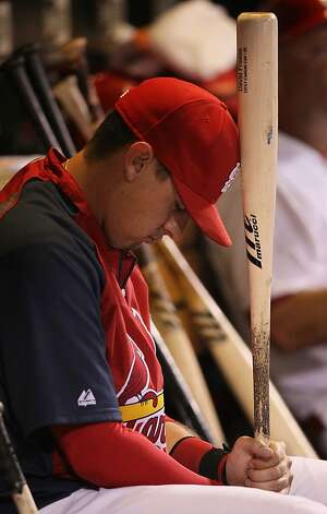 The St. Louis Cardinals' Allen Craig sits in the dugout holding a bat during a game against the San Francisco Giants on Wednesday, August 8, 2012, at Busch Stadium in St. Louis, Missouri. The Giants routed the Cards, 15-0. (Chris Lee/St. Louis Post-Dispatch/MCT) Photo: Chris Lee, McClatchy-Tribune News Service